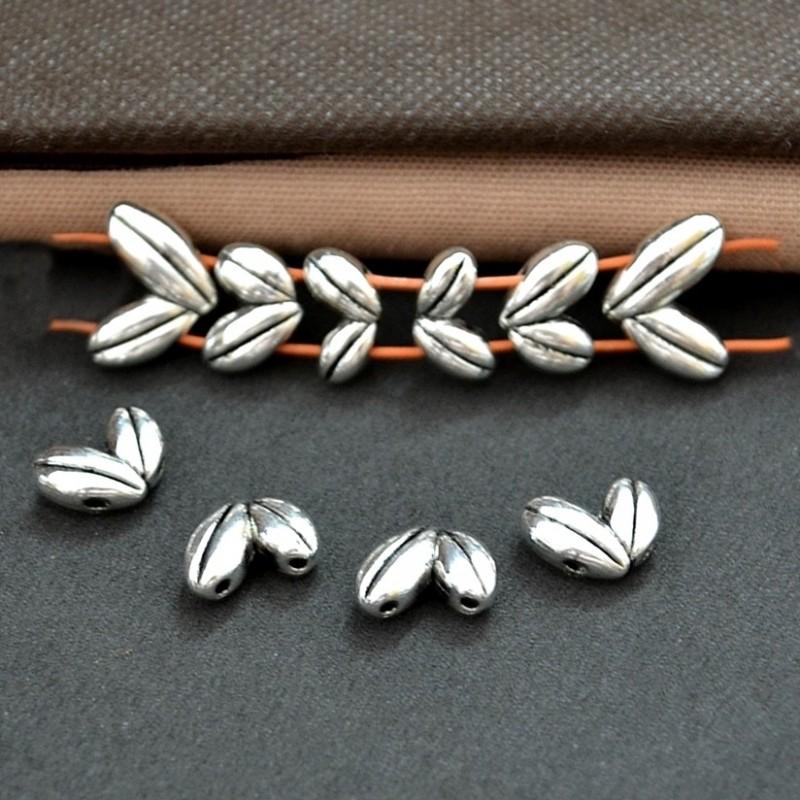 Distantiere , margele metalice frunze cu 2 orificii 14x10mm